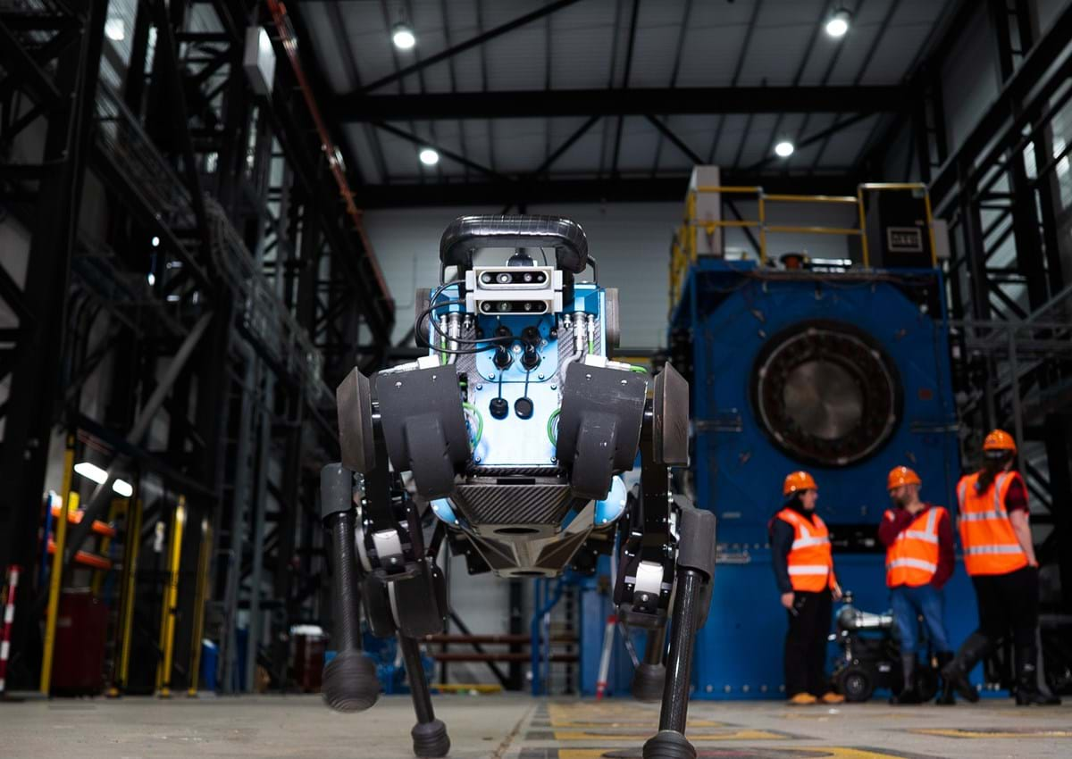 blue ANYmal B robot, standing in industrial site.